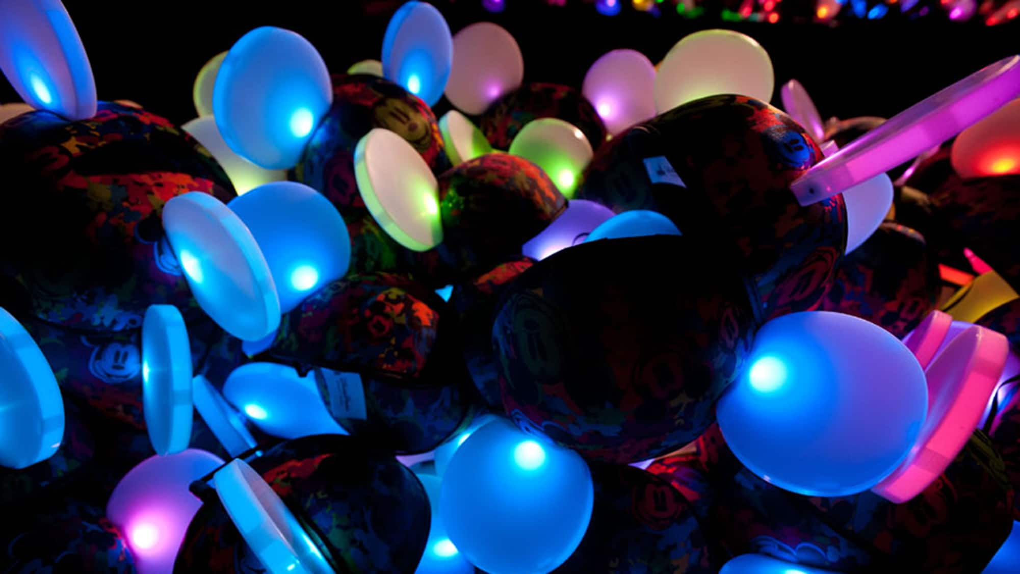 a20c9adc8b2 Glowing Mickey Ears light up as they sit piled together at night