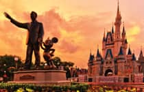 A statue of Walt Disney and Mickey Mouse, in front of Cinderella Castle at Magic Kingdom park