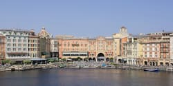 The exterior of the Tokyo DisneySea Hotel MiraCosta overlooking a waterfront area