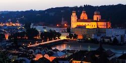 St. Stephen's Cathedral in Passau, Germany is lit up at dusk