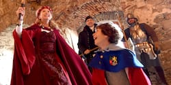 A mother and son get dressed up in historic costumes as they explore a castle