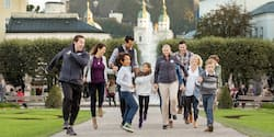 A family walks in the Mirabell Gardens