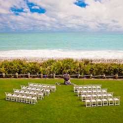 Chairs and flowers set up on the Croquet Lawn overlooking the ocean
