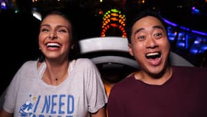 An excited couple ride Slinky Dog Dash together