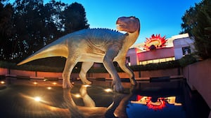 A large dinosaur at the entrance to the DINOSAUR attraction