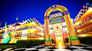 A building at Disney's All-Star Music Resort, with an entrance archway shaped like a jukebox