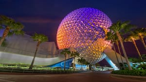 Spaceship Earth, the iconic centerpiece of Epcot, illuminated at night
