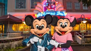 Mickey Mouse and Minnie Mouse, dressed formally at Hollywood and Vine