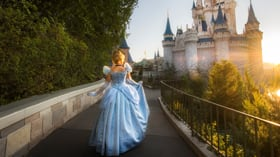 Cinderella walks toward Cinderella Castle