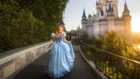 Cinderella walks toward Cinderella Castle