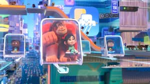Ralph and Vanellope sit in a moving vehicle as they travel through a cyber universe