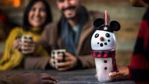 A cup shaped like a snowman wearing Mickey Mouse ears