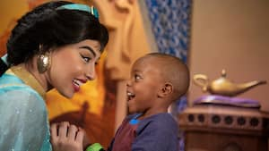 Princess Jasmine greeting a young boy
