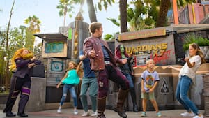 A girl dances with Star Lord, Gamora and other characters from Guardians of the Galaxy