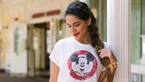 A Guest models a Mickey Mouse Club T shirt