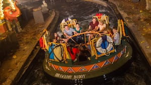 Guests of all ages holding on tightly while riding Kali River Rapids at Disney's Animal Kingdom park