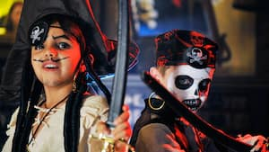 Girl and boy pirates wielding swords