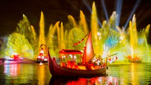 Projection and water effects illuminate the night during Rivers of Light at Disney's Animal Kingdom park