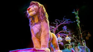 Simba stands tall during a performance of Festival of the Lion King at Disney's Animal Kingdom park