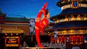 A female performer from Jeweled Dragon Acrobats poses during a show at the China Pavilion at Epcot