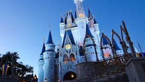 Cinderella Castle rising into the evening sky above Magic Kingdom park at Walt Disney World Resort