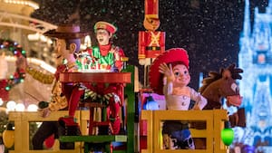 Woody and Jessie from the 'Toy Story' films perform during the Once Upon a Christmastime Parade