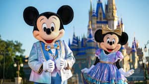 Mickey Mouse and Minnie Mouse, wearing sparkling new looks for The World's Most Magical Celebration in honor of Walt Disney World Resort's 50th anniversary.