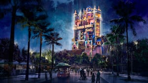 An artistic picture depicts the Hollywood Tower Hotel lit up colorfully at night, and Guest walking by.