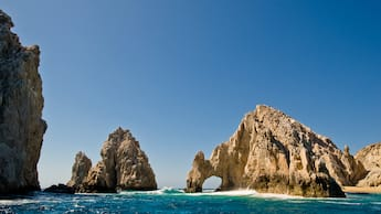 Two mountain shaped rock formations stand above the waves
