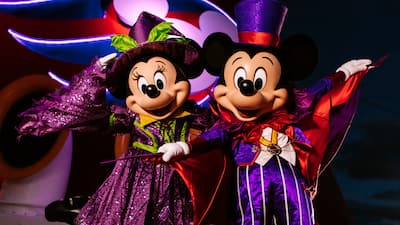 Dressed in Halloween attire, Mickey Mouse and Minnie Mouse perform aboard a Disney cruise