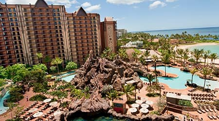 Disneys Aulani Resort in Hawaii overlooking swimming pools, the beach and the water