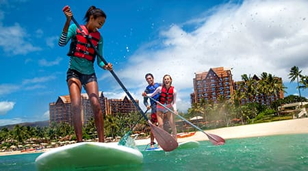 Attendees paddle surfing at Disneys Aulani Resort in Hawaii