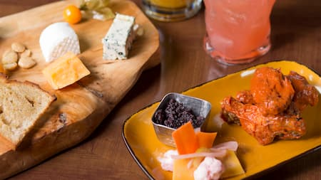 A charcuterie plate served with cheeses and crackers