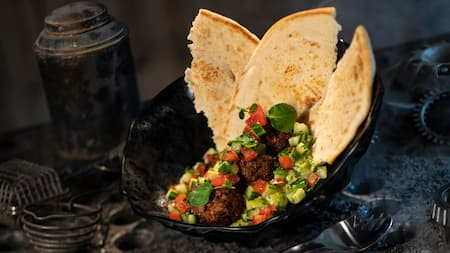 Felucian Garden Spread made with plant based kefta, herb hummus, tomato cucumber relish and pita.