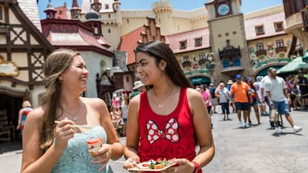 2 young Guests enjoy snacks and share a laugh in front of Storybook Treats