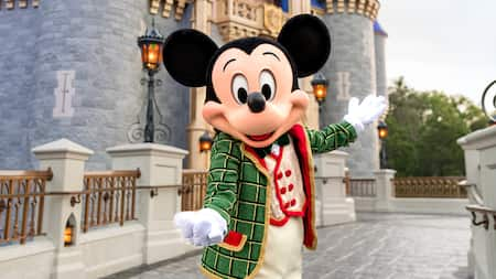 Mickey Mouse, dressed in his holiday finery, welcomes you to Cinderella Castle