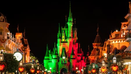 Cinderella Castle at night at the end of Main Street USA