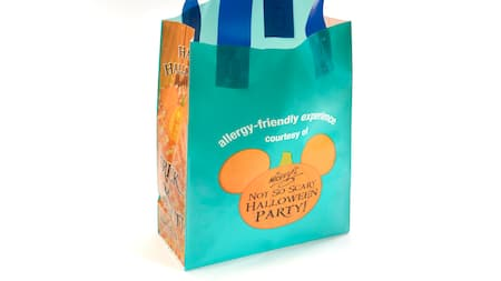 A trick or treating bag with the words 'Mickey's Not So Scary Halloween Party' on it