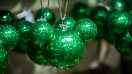 A Christmas ornament shaped like Mickey Mouse's head