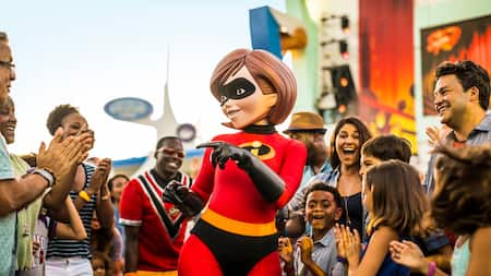The character Mrs. Incredible greets excited guests