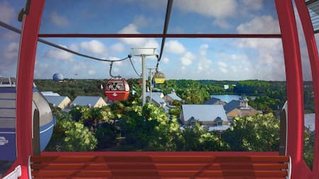 Disney Skyliner gondolas stretch over the tops of trees and buildings with Epcot in the background