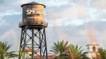 A water tower with the words Disney Springs