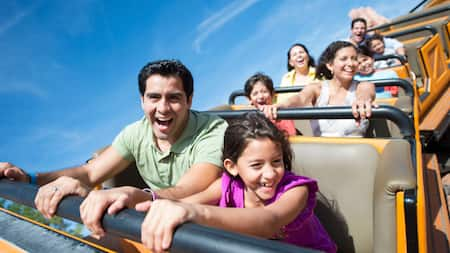 A father and daughter enjoying a roller coaster ride