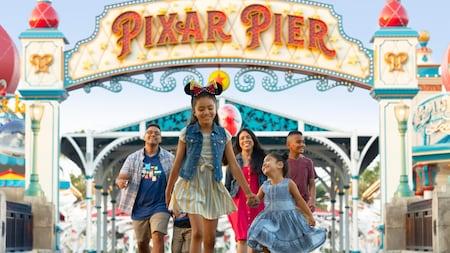 A family leaves Pixar Pier, looking very happy