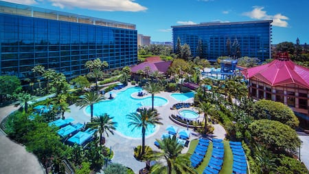 2 wings of the Disneyland Hotel flank its large swimming pool