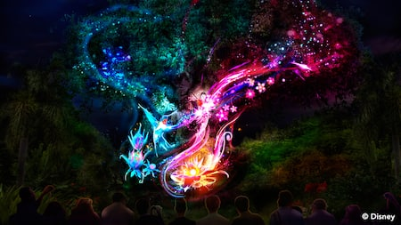 The glowing flight path of 2 hummingbirds forms the shape of a heart around the Tree of Life