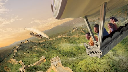 A family of Guests smiles while flying above the Great Wall of China during Soarin' Around the World
