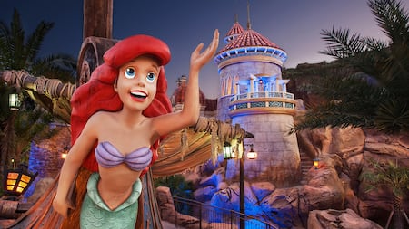 A cartoon drawing of Ariel waving from the bow of a ship near a lighthouse
