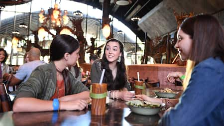 A group of young female Guests indulge in a meal in Satu'li Canteen at Pandora – The World of Avatar