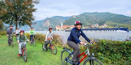 A family biking next to Danube River in Austria